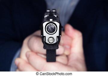 Man pointing a gun