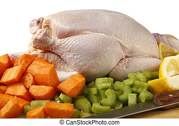 Chicken and veg for a stew - A raw chicken and the...