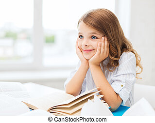 student girl writing in notebook at school - education and...