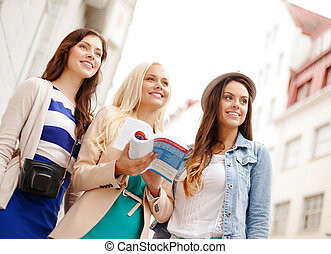 three beautiful girls with tourist book in city - holidays...