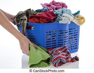 Dirty clothes in basket - Woman collects lots of laundry,...