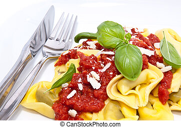 Tortellini on a plate - Tortellini with tomato sauce and...