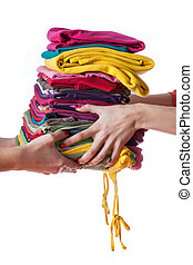 Ironed clothes - Heap of ironed washed clothes giving from...