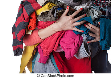 Pile of clothes - Woman holding a huge pile of clothes
