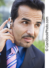 Businessman outdoors wearing headset (selective focus)