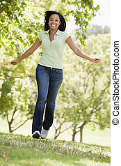 Woman running outdoors smiling