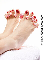 foot pedicure applying red toenails on white - foot pedicure...
