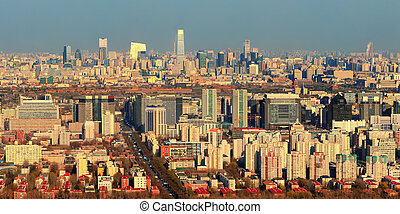 Beijing sunset aerial view with urban buildings.