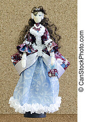 Handmade doll in a ball gown with bag on the stand