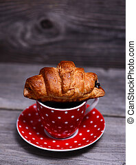 croissant on cup of coffee