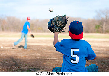 Two boys playing baseball at the park - Two boys playing...