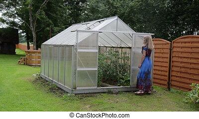 woman greenhouse door
