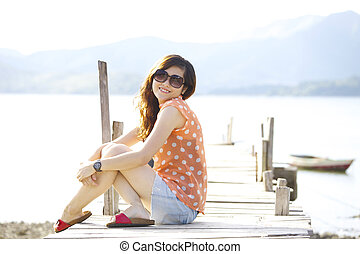 Asian woman smile at sunlight