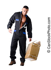 Muscular manual worker with open coveralls shows muscle...