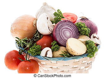 Basket with vegetables on white