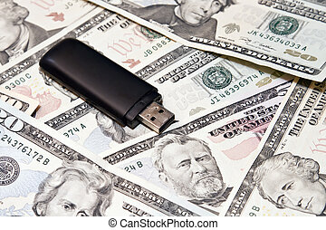 Usb flash drive lies on scattered dollars