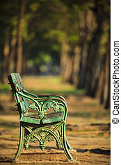 old green bench in park with blurry background use as copy...