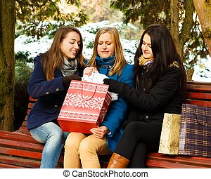 I don't want to share my present! - Young woment undoing...