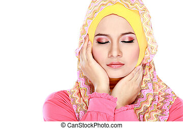 Fashion portrait of young beautiful muslim woman with pink...
