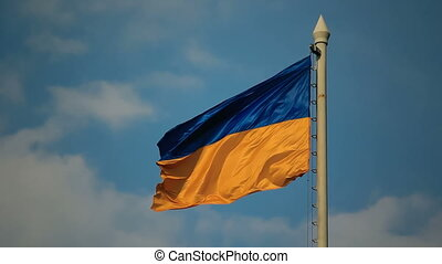 Flag of Ukraine against cloudy sky - Flag of Ukraine against...