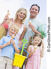 Family at beach with ice cream cones smiling