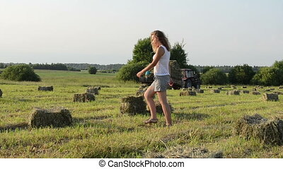 woman carry bale tractor - Beautiful farmer woman girl carry...