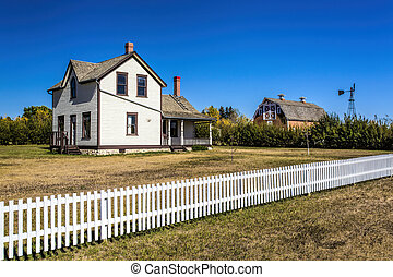 Old Farm House - An old prairie farm house with red barn.
