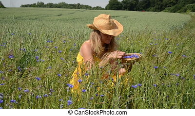 woman gather herb blooms