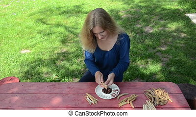 woman husk beans dish - pretty gardener girl shell unhusk...