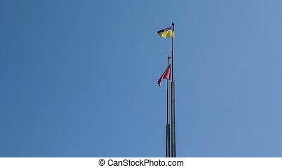 Flag of Ukraine against blue sky - Flag of Ukraine against...