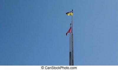 Flag of Ukraine against blue sky - Flag of Ukraine against...