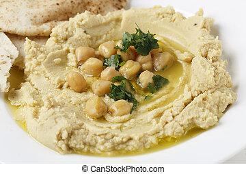 Masbacha close up - Arab masbacha, hummus dip served with...