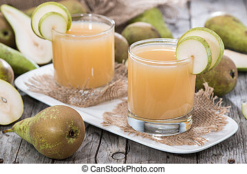 Glass filled with Pear Juice - Glass filled with freh made...