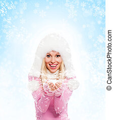 winter woman happy smile over blue show blowing background