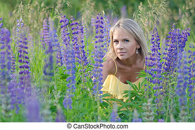 woman in the lupine field - Young beautiful woman in the...