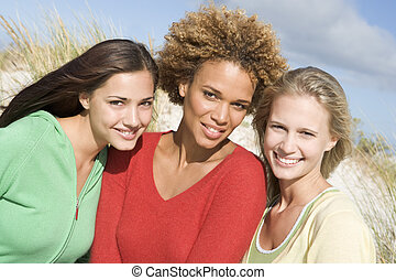 Three women posing outdoors