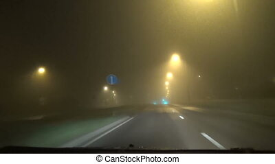 fog traffic light - View through the car windscreen Early...