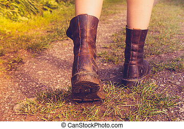 Close up on woman's muddy boots