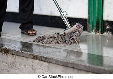 Cleaning mop   - Cleaning mop on nature background,