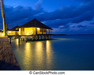 Overwater bungalows in tropical island