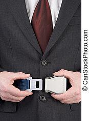 Businessman Fastening Safety Belt