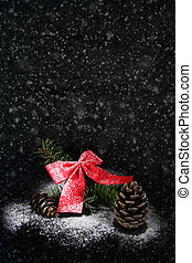 pine cone with bow and snow