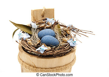 Bird nest with wooden tub on white background