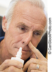 Senior Man Using Nasal Spray