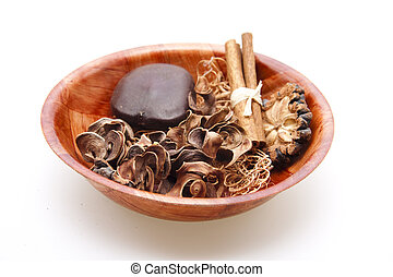 Potpourri in wooden bowl on white background