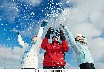 Young people in winter - Young people having fun with snow...