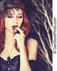 Redhead vampire woman in mask Photo in vintage style