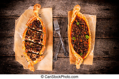 Turkish pide above - Two Turkish specialty on the...