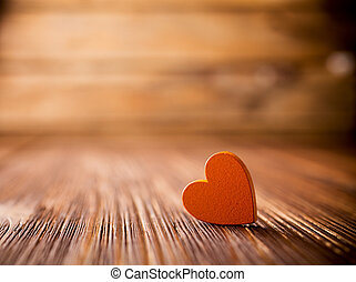 Heart. - Stone heart on a wooden background.