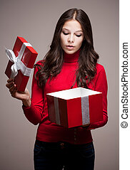 Christmas mystery - Portrait of a beautiful young brunette...